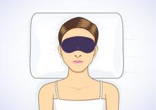 Schlafen im Bett mit Augenmaske Stockbild