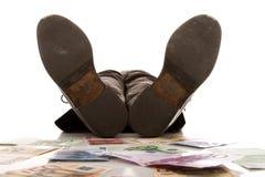 Schlafen mit dem Geld Stockfotografie