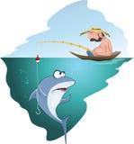 Schlafender Fischer fängt einen Fisch Lizenzfreies Stockfoto
