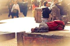 Schlafender nepalesischer Mann Stockfotos
