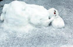 Schlafender Schneemann Stockfoto
