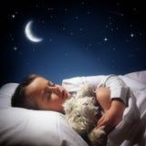 Schlafender und träumender Junge Stockfotografie
