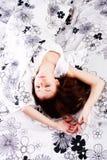Schlafendes junges schönes Mädchen Stockfotos