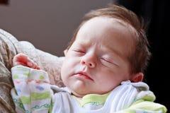 Schlafendes und träumendes Baby Lizenzfreies Stockbild