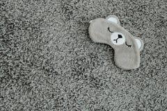 Schlafenmaskenhintergrund stockbild