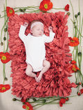 Schlafenneugeborene Babyblumen Stockbild