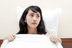 Schlaflosigkeit verursachte einen Albtraum Stockfotografie