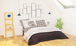 Schlafzimmer mit Fotorahmen auf einer Wand lizenzfreie stockbilder