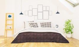 Schlafzimmer mit Fotorahmen auf einer Wand stockbilder