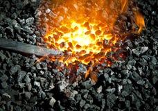 Schlagen Sie das Eisen während sein heißes Lizenzfreie Stockbilder