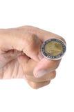 Schlagen Sie die Münze leicht Stockbild