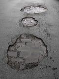 Schlaglöcher/Straßenschaden Lizenzfreies Stockbild