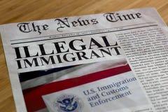Schlagzeile des illegalen Einwanderers Stockfotografie