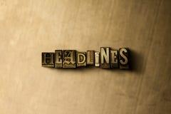 SCHLAGZEILEN - Nahaufnahme des grungy Weinlese gesetzten Wortes auf Metallhintergrund Lizenzfreies Stockbild