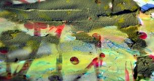Schlamm, Farbe und rote wächserne Stellen, abstrakter Hintergrund Stockbild