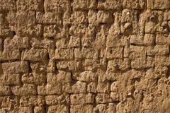 Schlamm-Lehmziegelmauer-Beschaffenheit Stockfotografie