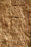 Schlamm-Lehmziegelmauer-Beschaffenheit Stockfotos