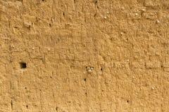Schlamm-Lehmziegelmauer-Beschaffenheit Lizenzfreie Stockfotografie