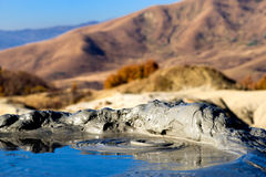 Schlamm-Vulkane bei Berca, Rumänien Stockfotos