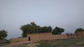 Schlammhaus am Abend in einem Dorf stockbild