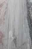Schlammige Schotterweg- und Reifenbahnen Lizenzfreies Stockbild
