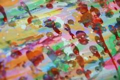 Schlammiger wächserner klarer Hintergrund in den klaren bunten Farben Stockfoto