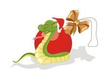 Schlange mit Weihnachtskugel Stockfoto
