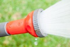 Schlauchleitungs-Wasser-Orange Stockbilder