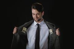 Schlauer Geschäftsmann mit Dollarbanknoten in den Taschen lokalisiert auf Schwarzem Stockbilder