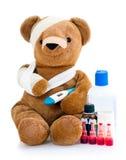 Schlecht Teddybär mit Medizin lizenzfreies stockbild