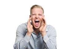 Porträt des verärgerten Geschäftspersonenschreiens. Stockfotografie