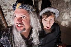 Schlechter Zauberer mit Sohn Stockbilder