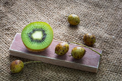 Schleichera oleosa (Lour.) Oken and kiwi tropical fruit on tradi Stock Photography