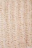 Schließen Sie herauf Beschaffenheit des woolen beige Schals stockbilder