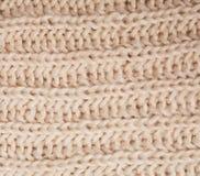 Schließen Sie herauf Beschaffenheit des woolen Sahneschals stockbild