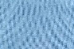 Schließen Sie herauf Beschaffenheits-Hintergrund des blauen Polyester-Gewebes Lizenzfreies Stockbild