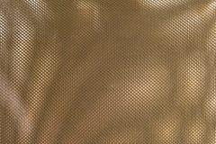 Schließen Sie herauf Beschaffenheits-Hintergrund des Bronze-Polyester-Gewebes Lizenzfreies Stockbild
