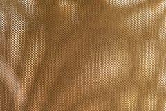 Schließen Sie herauf Beschaffenheits-Hintergrund des Bronze-Polyester-Gewebes Stockbild