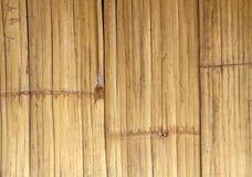 Schließen Sie herauf braunen Bambuszaunhintergrund Stockfoto