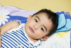 Schließen Sie herauf das Gesicht des asiatischen Jungen Stockfotografie