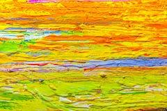 Schließen Sie herauf die bunte Acrylfarbe, die auf Segeltuch gemalt wird Stockfoto