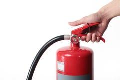 Schließen Sie herauf Feuerlöscher und fangen Sie auf rotem Behälter Lizenzfreie Stockfotos