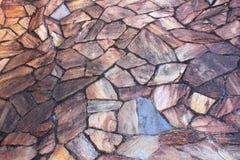 Schließen Sie herauf Foto einer alten Steinwand Stockfotos