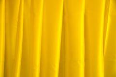 Schließen Sie herauf gelben Kordsamtgewebezusammenfassungs-Beschaffenheitshintergrund Lizenzfreie Stockfotografie