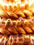 Schließen Sie herauf Goldthread und klare Perlen Lizenzfreie Stockbilder
