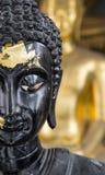 Schließen Sie herauf halbes Gesicht von einem schwarzen Buddha Stockfotos