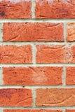 Schließen Sie herauf Hintergrundrot-Backsteinmauer Stockfotografie