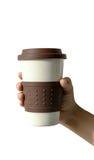 Schließen Sie herauf Kaffeetasse in der Hand auf Isolathintergrund Lizenzfreies Stockfoto