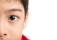 Schließen Sie herauf linkes Auge eines kleinen Jungen Lizenzfreies Stockfoto