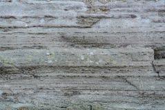 Schließen Sie herauf Makrohintergrundbeschaffenheit der alten grauen Wand, die mit bedeckt wird stockfotografie